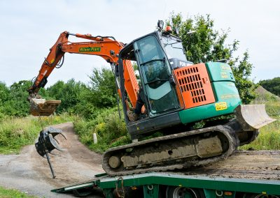 Digger coming off trailer-1